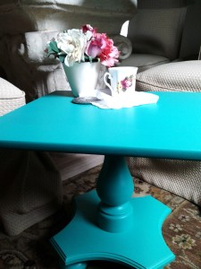 Vintage side table refinished in emerald green chalk paint.