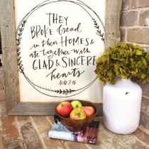 Trash to treasure project using an old barn wood frame and a tea towel from Mary & Martha.