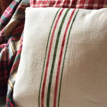 Making your own faux grain sack stripe drop cloth pillows is an expensive way to add a little French flair to your home.