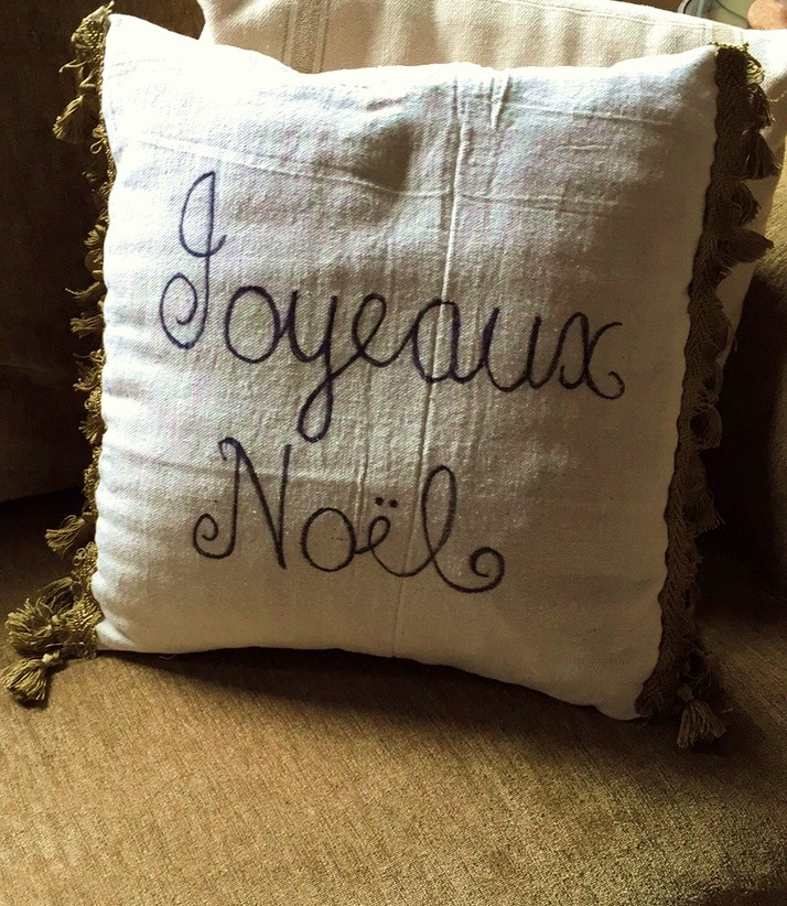 Making your own faux grain sack stripe drop cloth pillows is an inexpensive way to add a little French flair to your home.