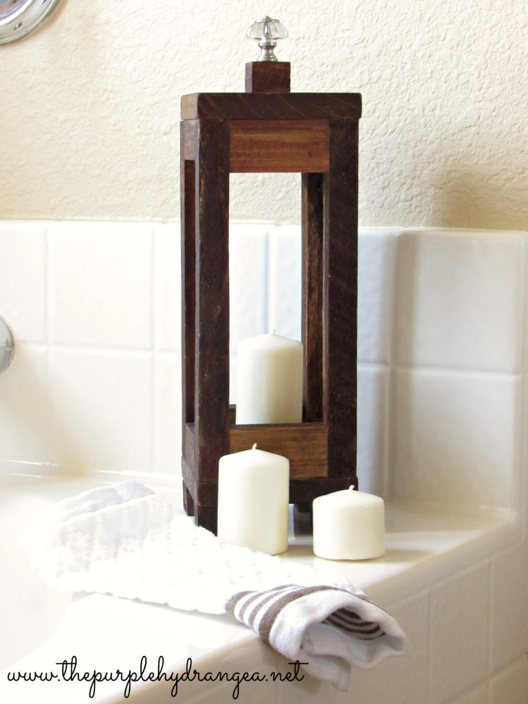 This scrap wood lantern added a rustic touch to my $100 master bathroom makeover.
