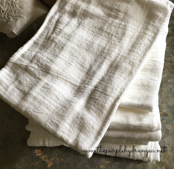 DIY grain sack stripe towels make the perfect gift for all those teachers, moms, and brides. You can make 5 for under $10!