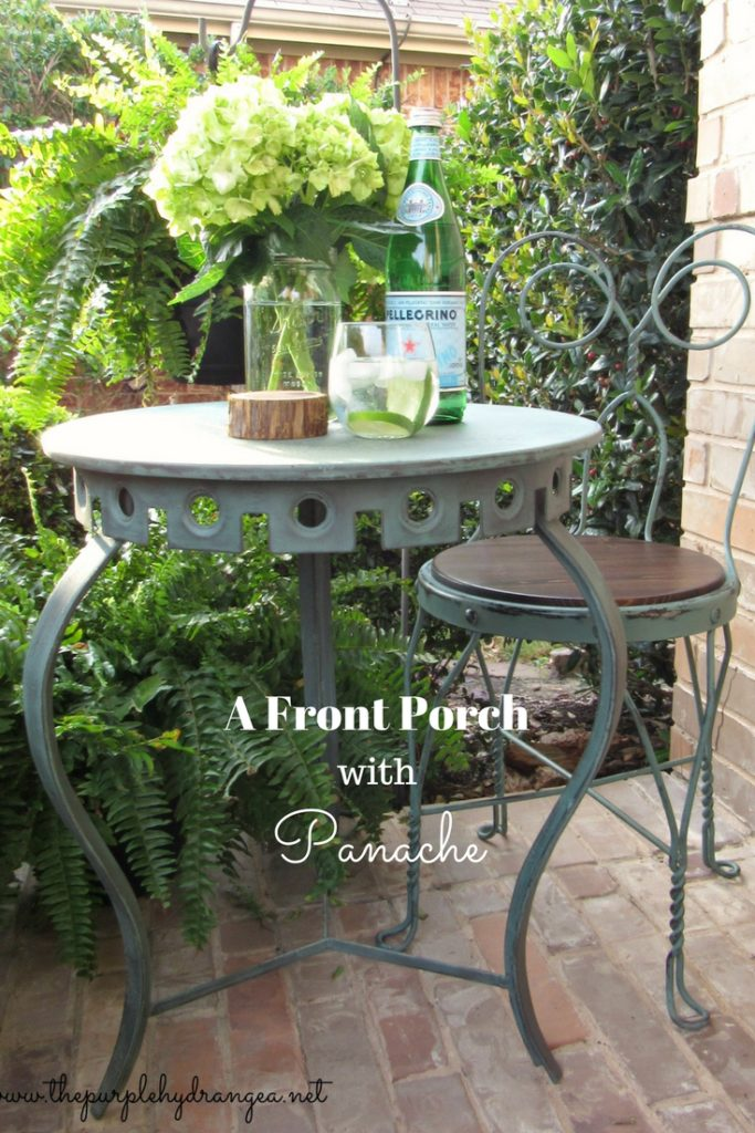 Using flea market finds, paint, and plants, I added a little panache to my bland front porch!
