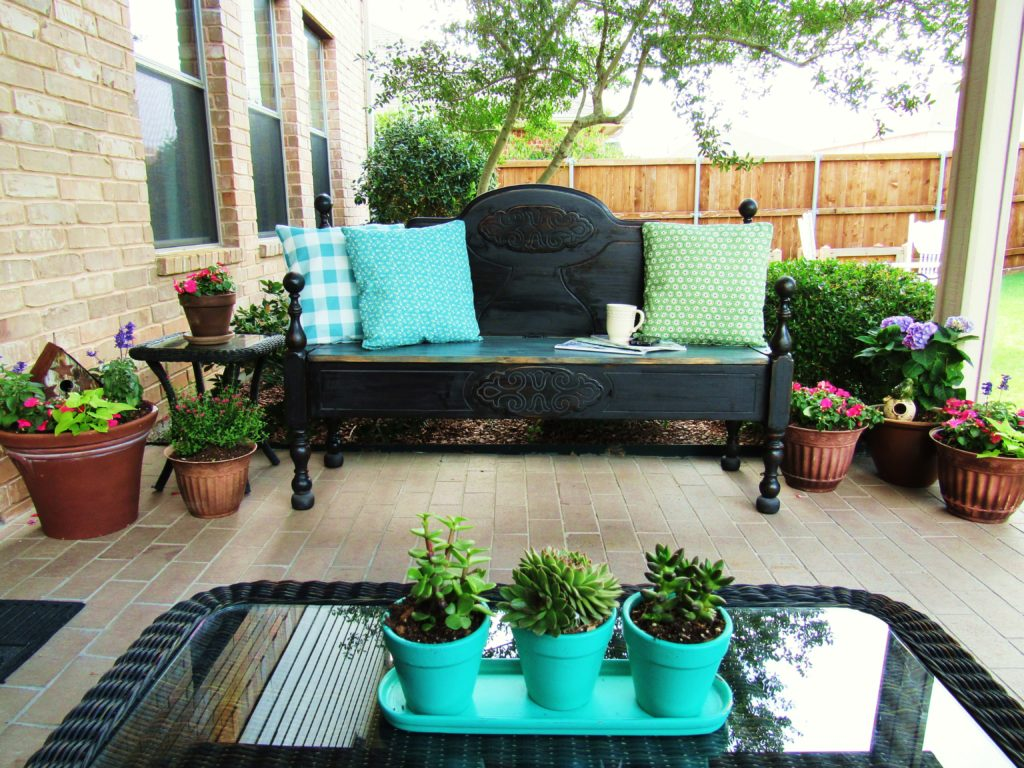 Patio makeover with a DIY headboard bench.