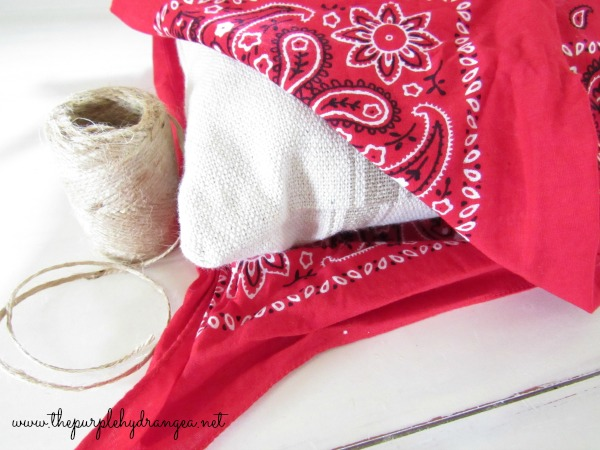 A no sew bandana pillow is a quick, easy, and inexpensive way to make outdoor pillows.