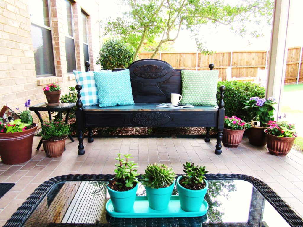 My patio has a new look complete with a headboard bench with storage. Visit www.thepurplehydrangea.net to see the rest of the makeover.