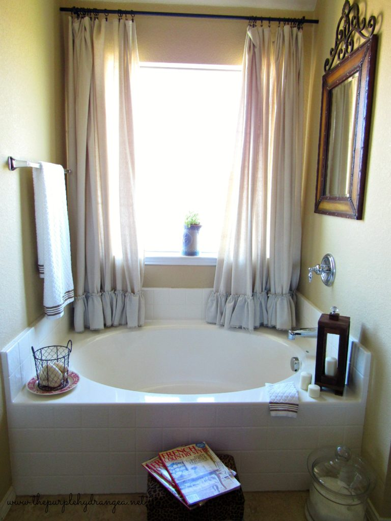 My $100 master bathroom makeover is complete with a little vintage, French, and rustic elements.