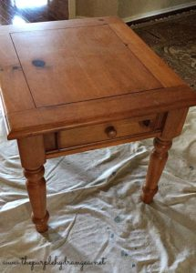 This is a not so great before shot of a honey pine end table I painted using Miss Mustard Seed's Milk Paint in Linen.