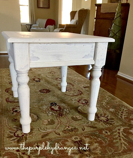 This farmhouse style side table has two coats of Miss Mustard Seed's Milk Paint in Linen applied prior to using Tough Coat to seal the chipping.