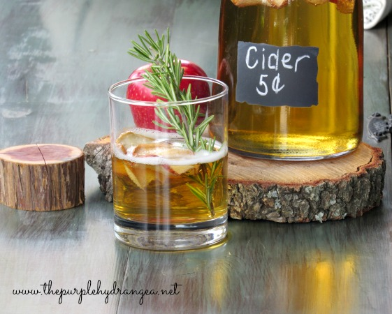 I'm serving apple cider when you visit my early fall front porch. I used simple, rustic, and refined elements to create all the fall feelings.