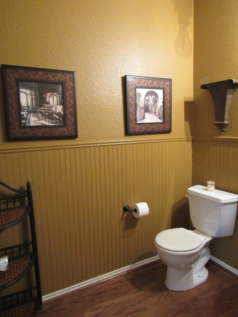 This powder room makeover is all about how changing your wall color can totally transform your room.