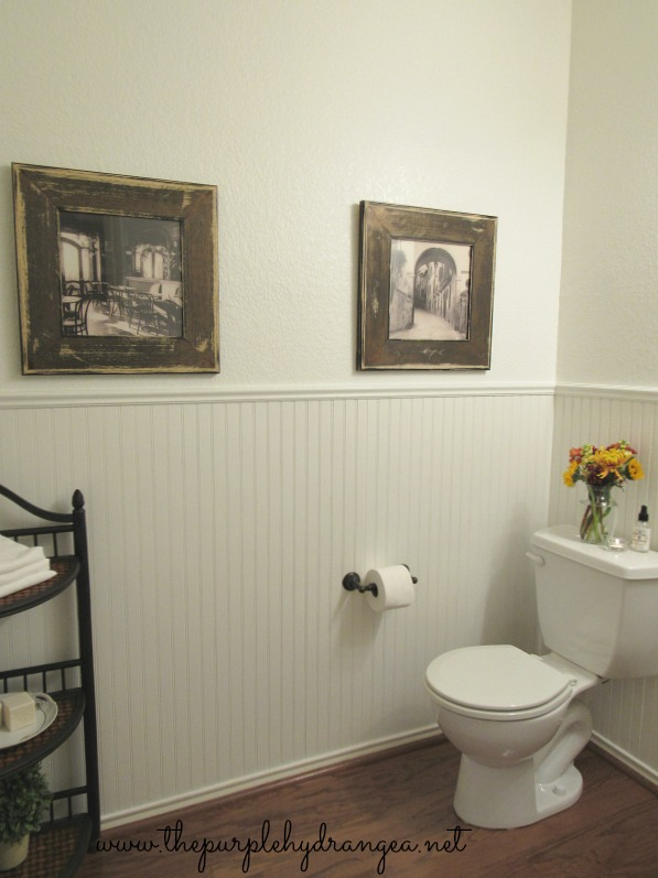 The star of this powder room makeover is definitely the clean new wall color. Swiss Coffee by Sherwin Williams totally transformed this dark and gloomy space.