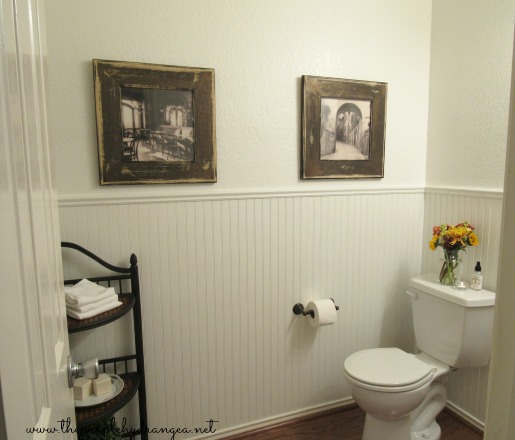 The star of this powder room makeover is definitely the new wall color by Sherwin Williams in Swiss Coffee. It totally transformed the room.