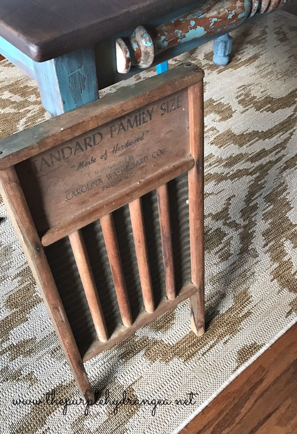 Antique washboard used a backdrop for my drop cloth wreath project.