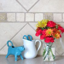 Sometimes it's just not in the budget to replace your kitchen backsplash. There are ways to update it, you just need to be a little creative.