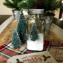 Here's a budget friendly upcycled Christmas gift idea. All you need is an empty spice jar, Epsom salts, and a bottle brush tree to make an extra easy ornament to give or keep, or both!