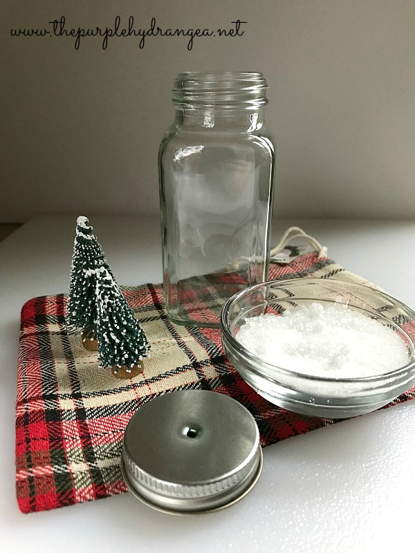 If you have an empty spice jar you can make an upcycled Christmas ornament using Epsom Salts, bottle brush trees, and a little ribbon.
