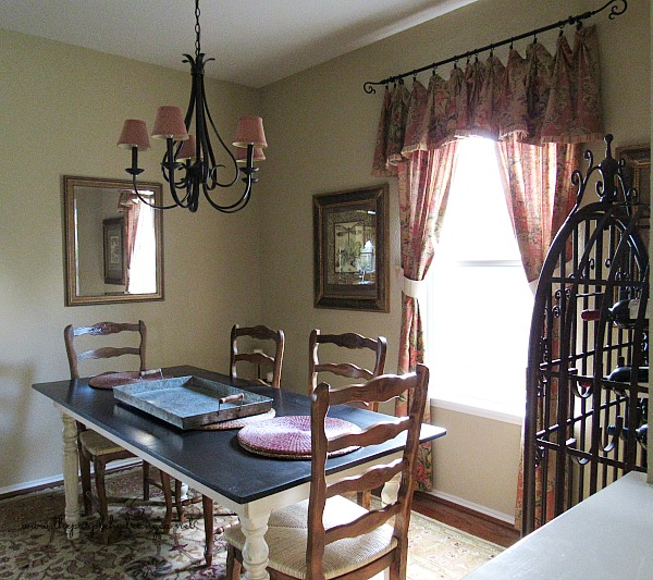 This is my formal dining room before I gave it a budget friendly makeover for under one hundred dollars.