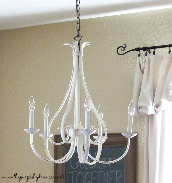 I painted this oil rubbed bronze chandelier with a little chalk type paint as part of my budget-friendly dining room makeover. I spent less than $100 and added a whole bunch of style.