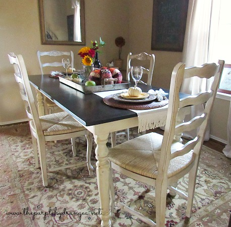 I added French Country style touches for under $100 as part of my budget-friendly  dining room makeover.
