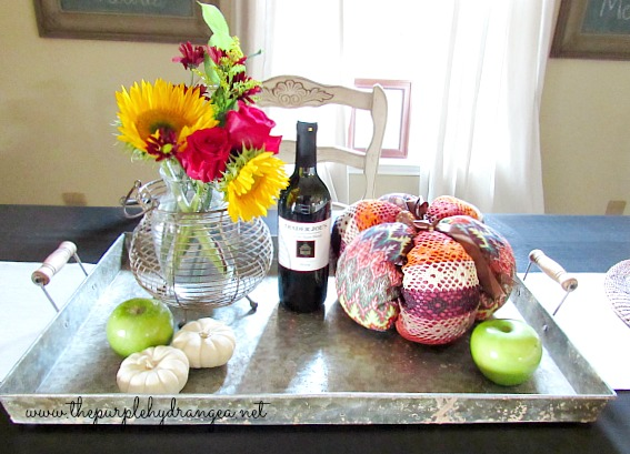 Using what you already own is the key to a budget-friendly dining room makeover; or any room for that matter. This tray came home with me from the Magnolia Market about two years ago.