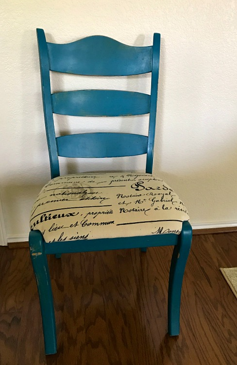 This farmhouse style chair looked a little dated with it's teal chalk style finish. Using paint stripper I gave it a springy look for under ten dollars.